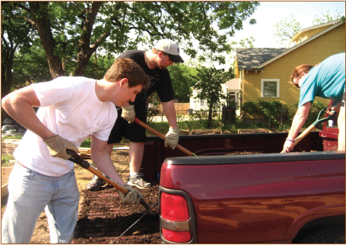 Figure 1. Fairmount Community Garden, one of the study sites, is mixed-income and ethnically diverse, with large numbers of white and Latino/a residents. Here, students are applying mulch.